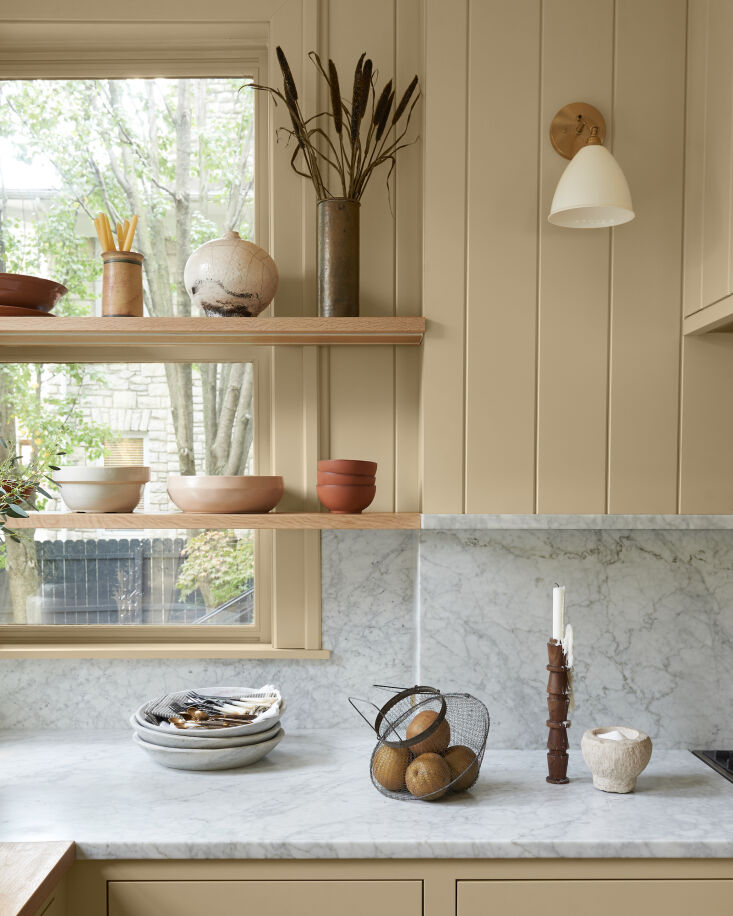 note the two different countertop materials, bianco gioia marble on one side, w 11