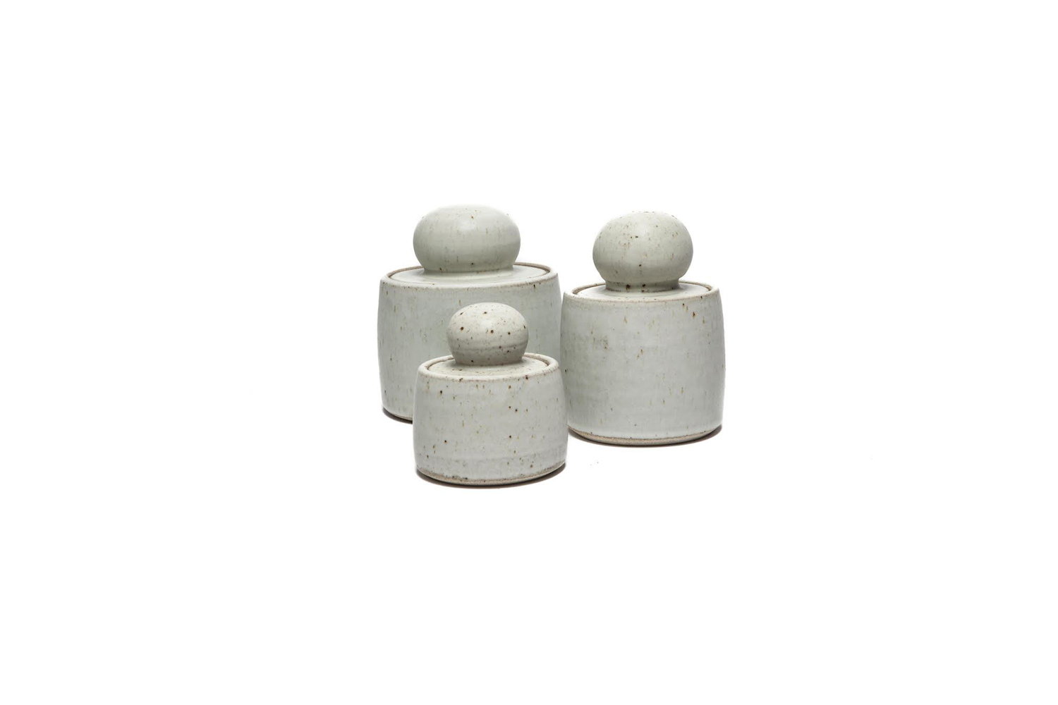 the ceramic stash pots are finished in a cream matte glaze with speckle detail; 21