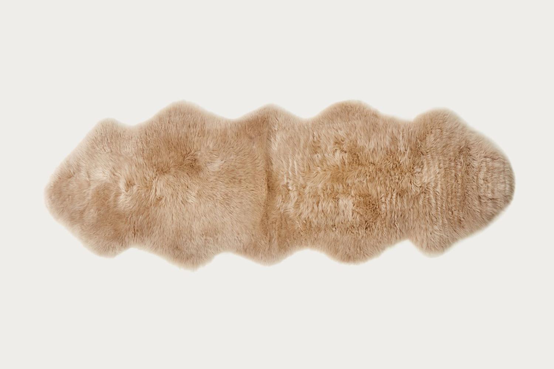 the jenni kayne double sheepskin in dark linen is \$\260. 23