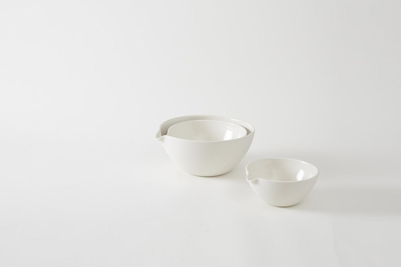 the john julian porcelain mixing bowls seen on the countertop start at \$\100 f 21
