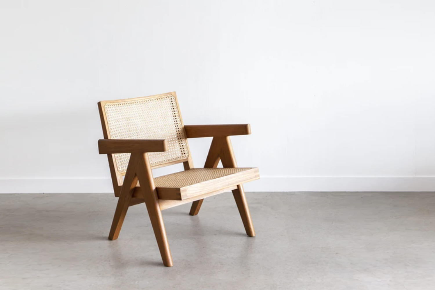 the pierre jeanneret re edition easy armchair is available through tigmi tradin 14