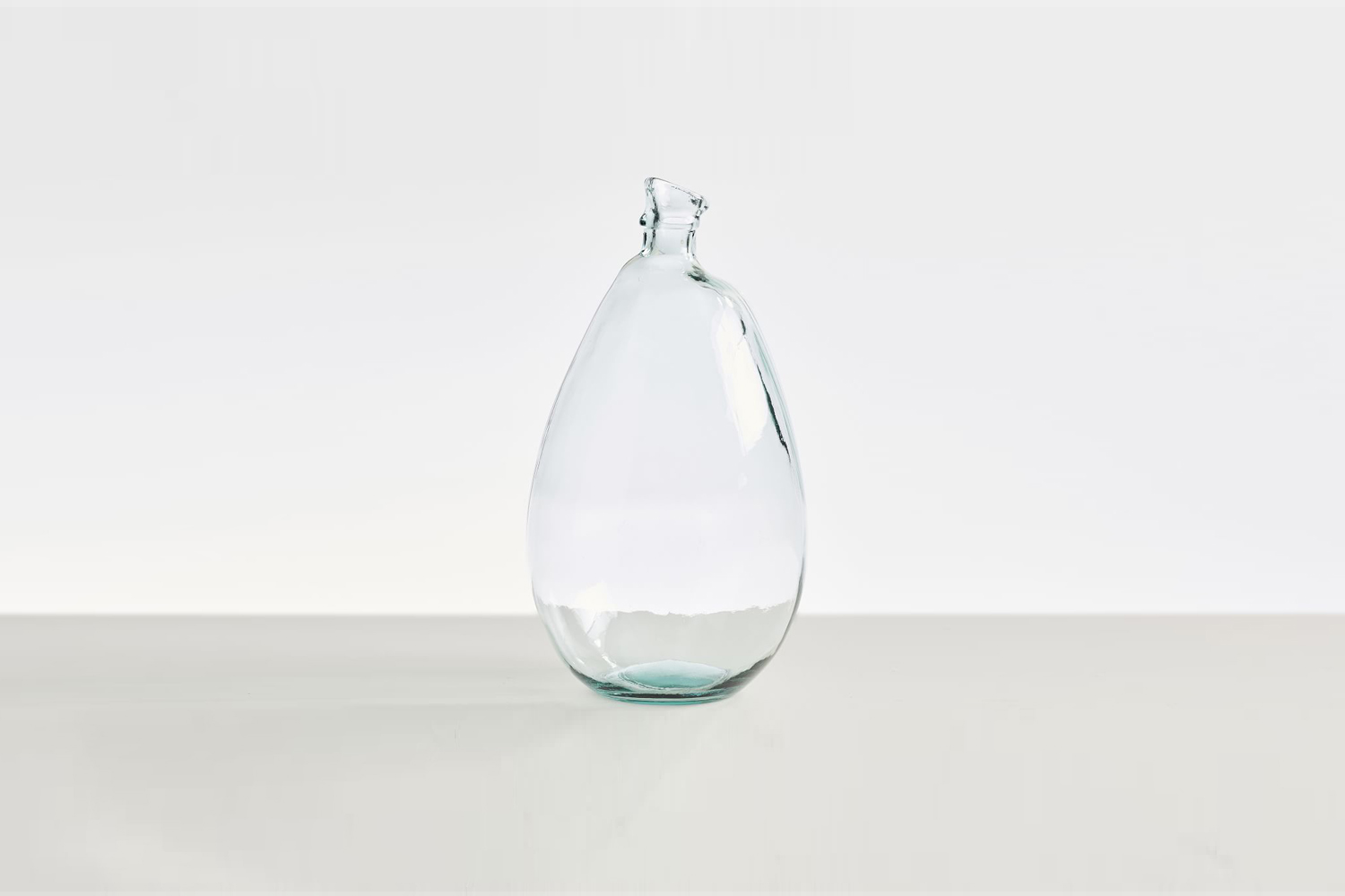 the aurora recycled glass vase in clear glass is \$49.50 at pottery barn. 21