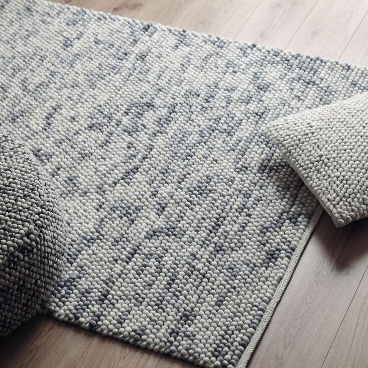 among the rug offerings is the ravi wool rug (shown here in grey melange, \$589 15