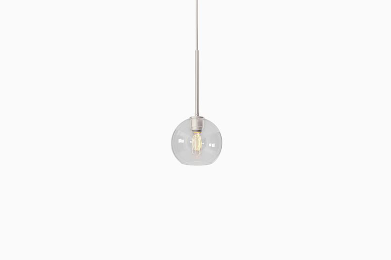 the sculptural glass globe pendant in clear comes with four different finishes; 12