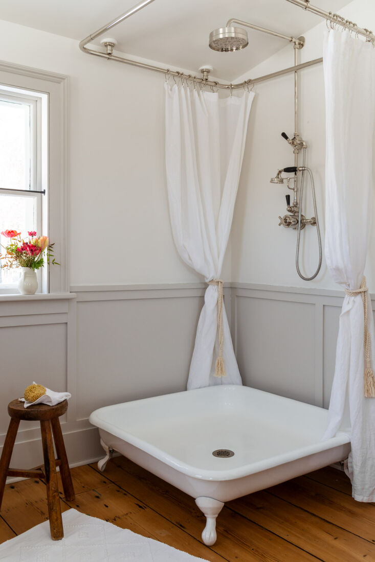 also in the bath: a charming and unusual footed shower basin. 19