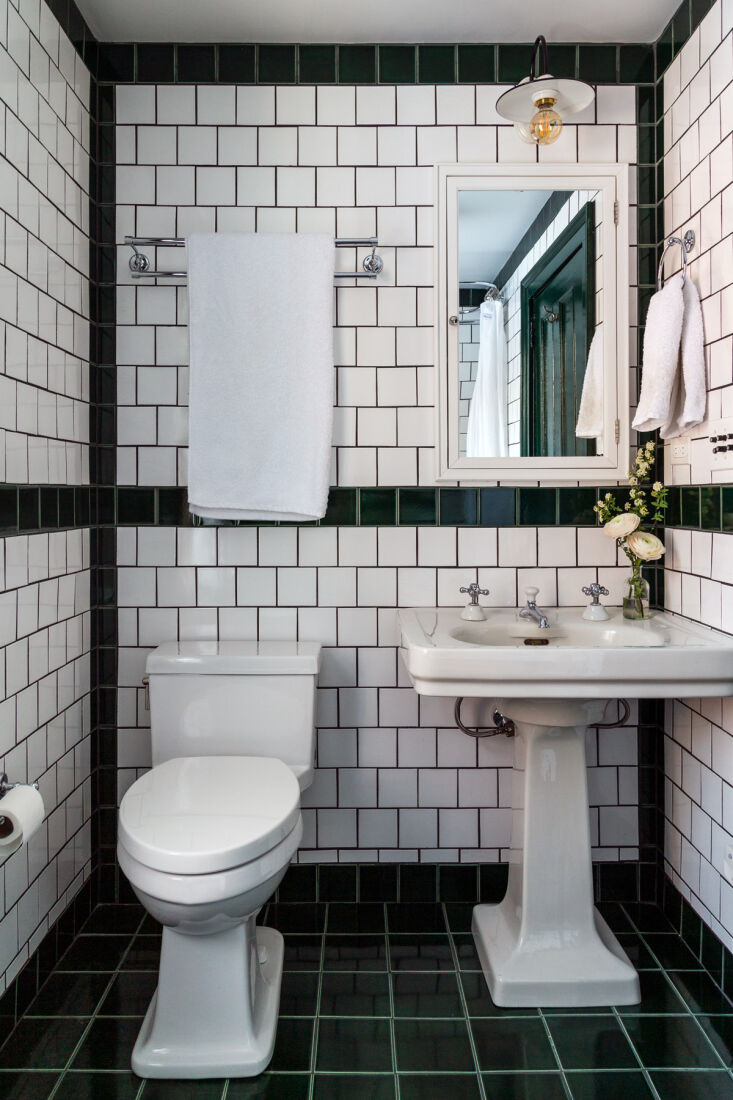 a green tiled guest bath has plenty of old fashioned appeal, with a vintage ped 21
