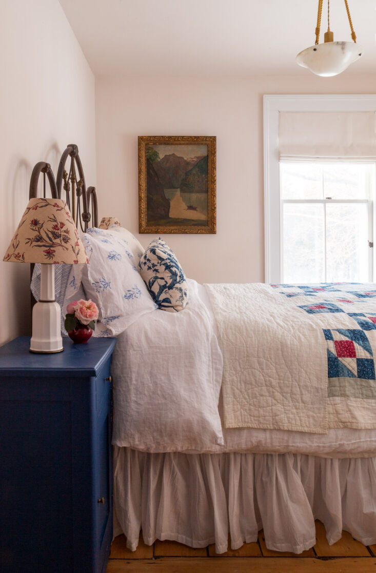 an antique iron bed made up in mix and match patterns stands ready to welcome o 17