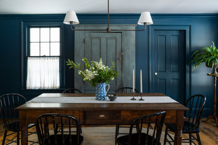 the dark and moody dining room, with a \19th century shaker cupboard and black  12