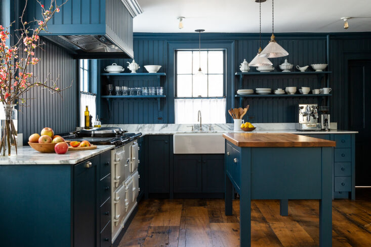 in the kitchen, the couple designed the shaker cabinetry themselves and trimmed 10
