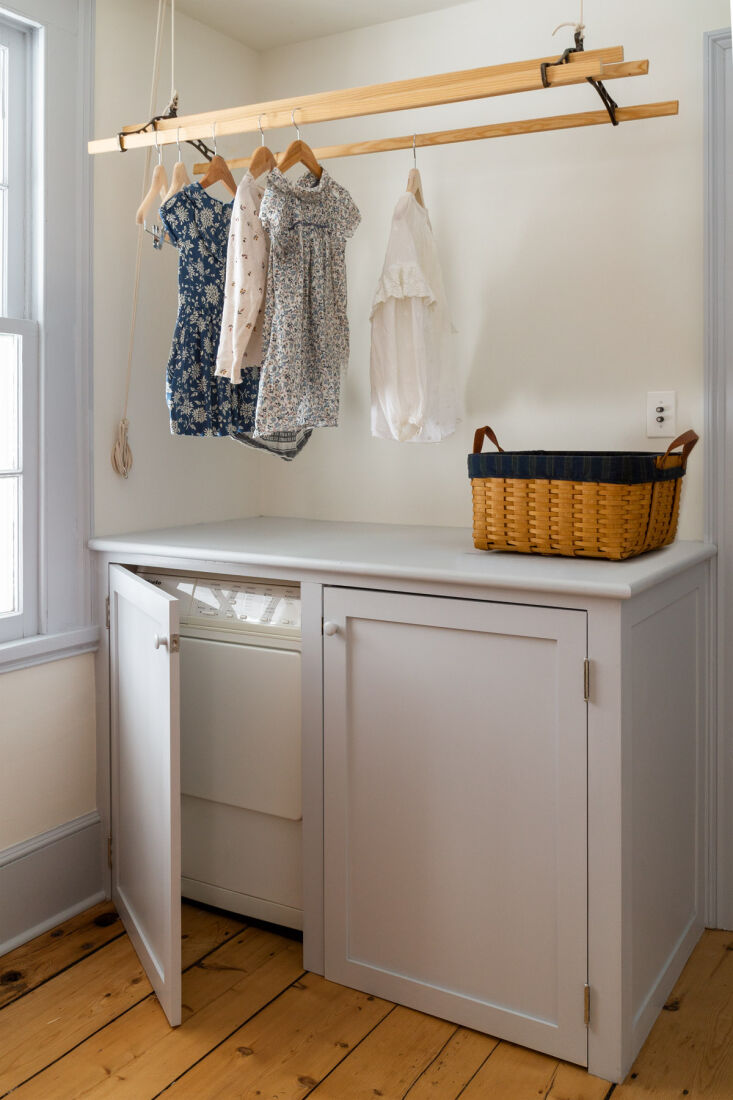 the efficient laundry room features a hanging sheila maid. (read more about the 15