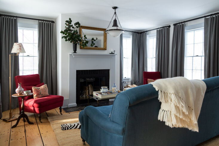 the family&#8\2\17;s snug living area features a sofa (a custom white arrow 13