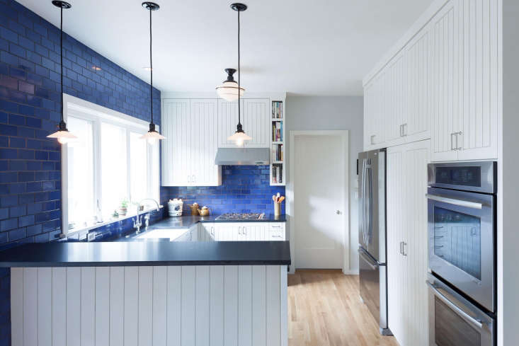 in the remodel of this u shaped kitchen in portland, oregon,opal blue tiles b 19